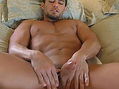 Cody begin his stroking fun in a tub and finish in a bed.
